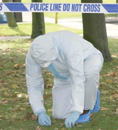 Police forensic investigator at a crime scene
